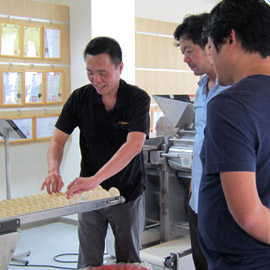 Our sales manager is presenting a dumpling making equipment to clients
